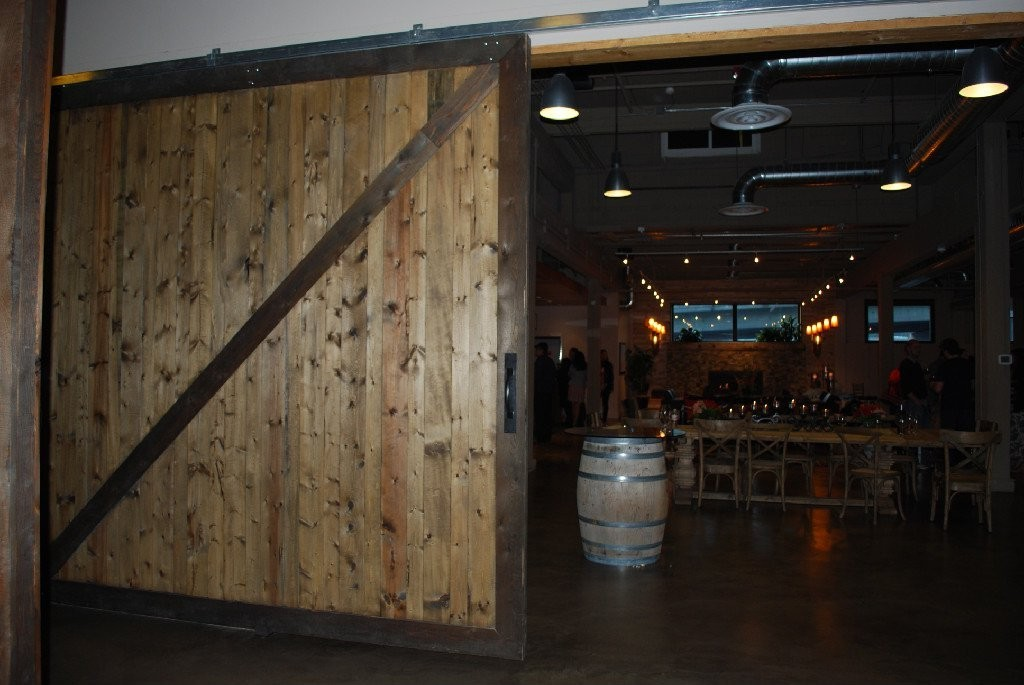 Restaurant bar room dividers rustic cedar sliding barn for Oversized barn doors