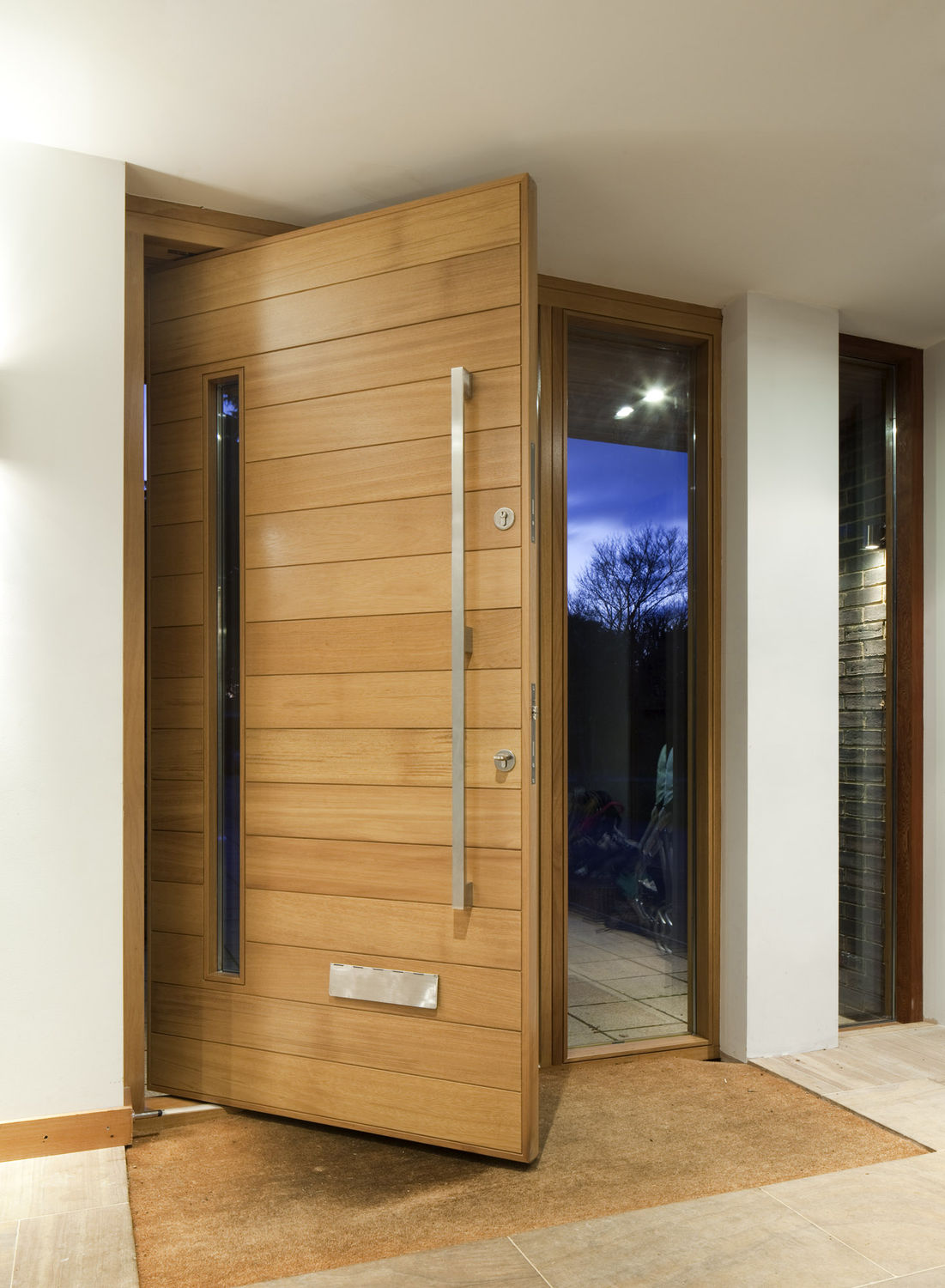 Architectural pivot door contemporary architecture for Large wooden front doors
