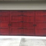 Bi fold carriage garage doors non warping solid wood stave insulated